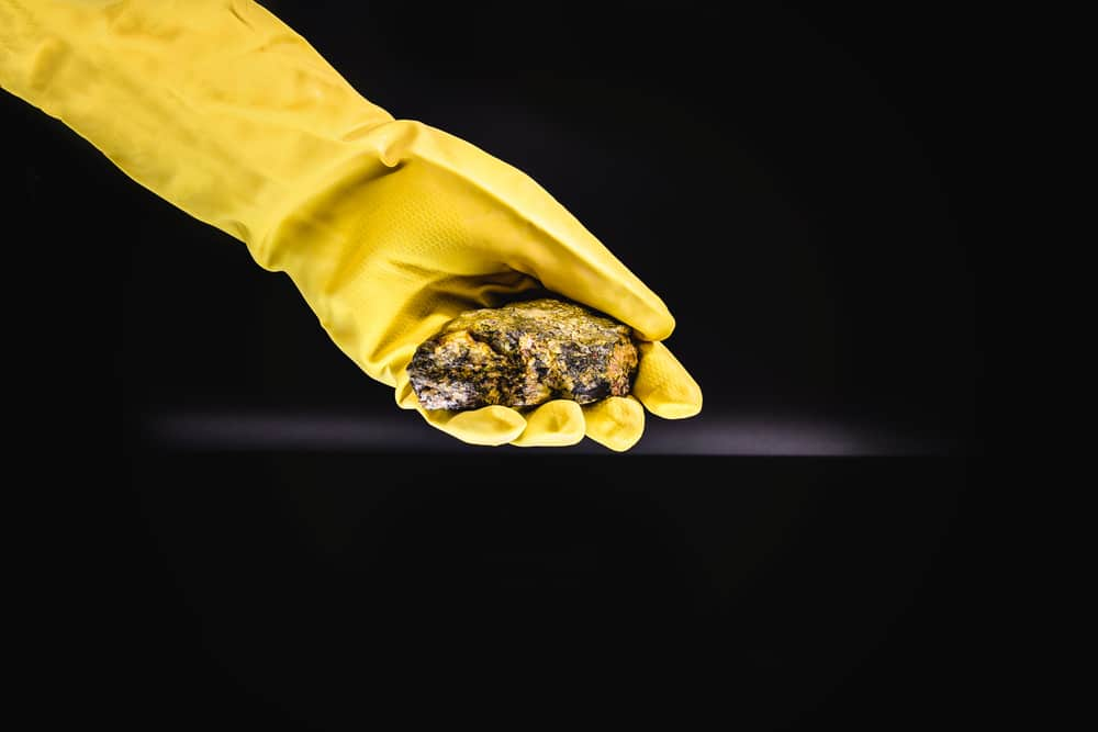 production of enriched uranium. Uranium ore found in nature. Yellow and radioactive stone. Risk of radiation.